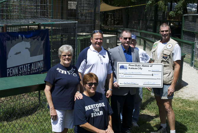 Members of the Penn State Alumni of Kansas City presented a check to Cedar Cove Feline Sanctuary to kick off a new philanthropic relationship.